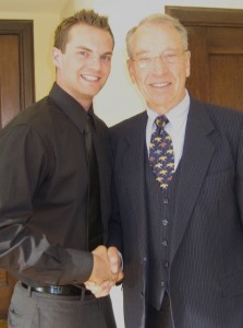 Travis Lloyd With Senator Grassley after speaking at casey family programs event